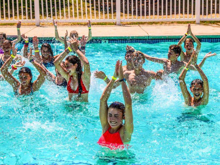 Campers practicing their water aerobics skills.