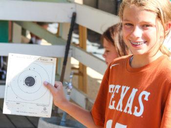 A camper showing their bb gun target sheet.