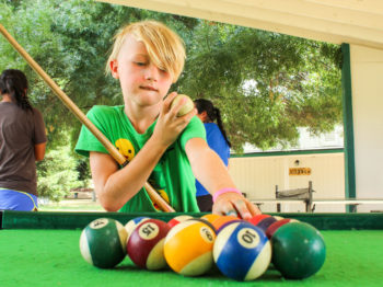 A camper setting up for a game of billiards.