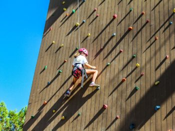 A view of a camper climbing the rock wall.