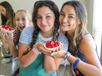 Campers posing with their dessert.
