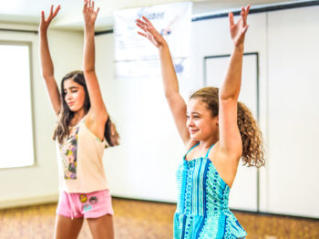 Two campers learning a dance routine.