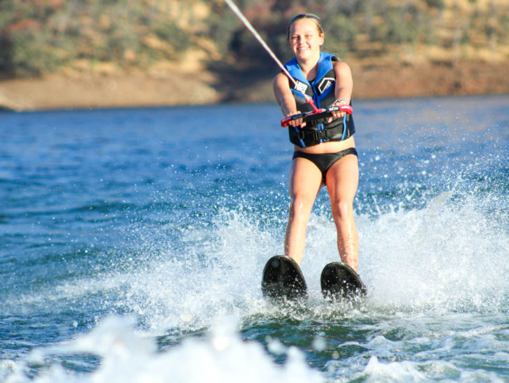 A camper water skiing.