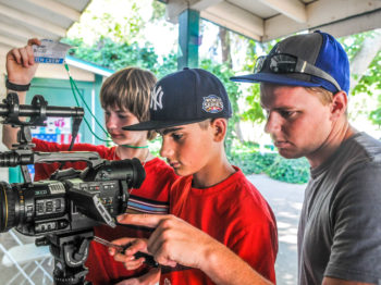 Campers learning how to shoot videos.