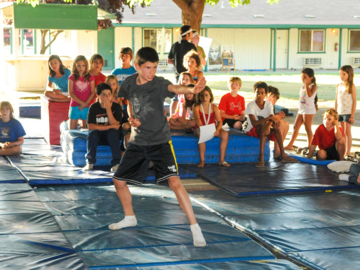 A camper learning how to do martial arts.