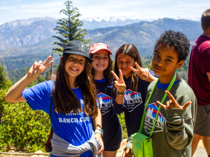 Campers posing for the camera in front of the Sequoia National Forest