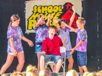 Campers performing a skit in front of an audience.