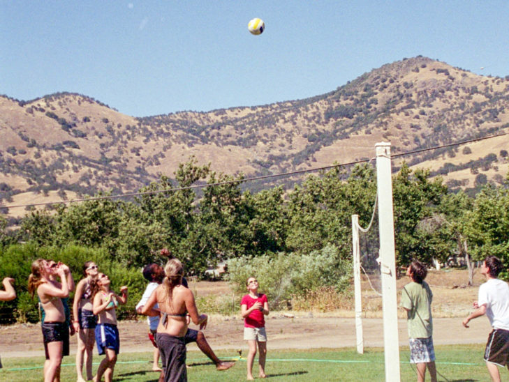 Campers playing volleyball.