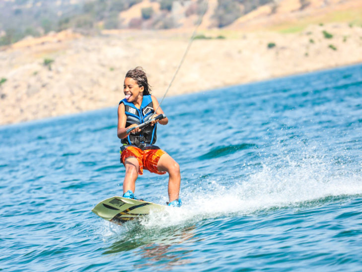 A camper having fun while wakeboarding.