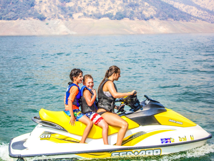 Campers having fun while on a waverunner