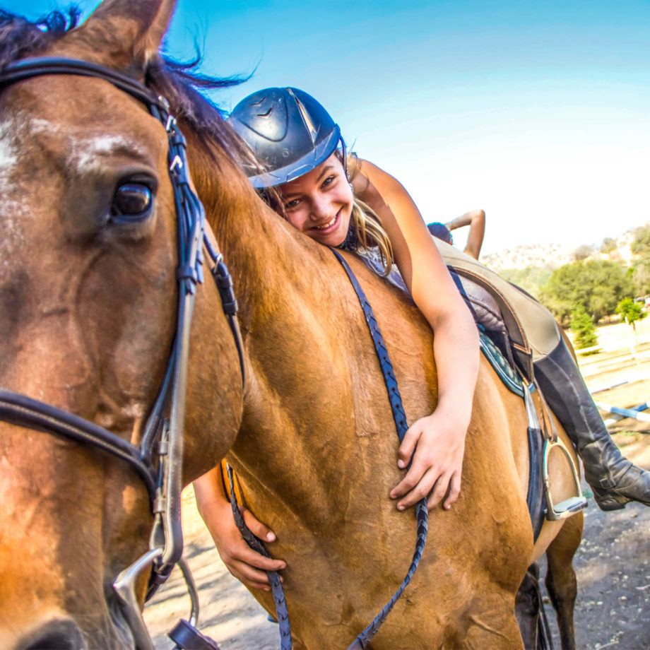 A camper on a horse.