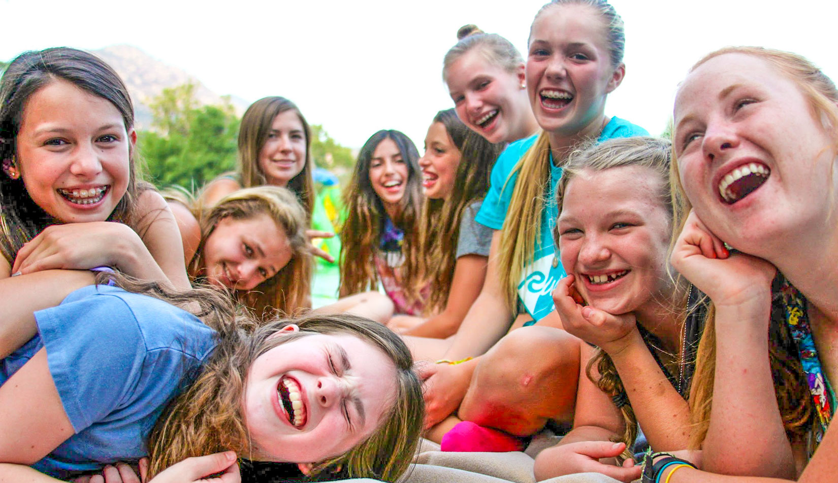 A group of campers laughing and smiling.