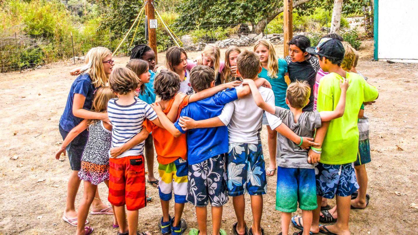 Campers huddling together