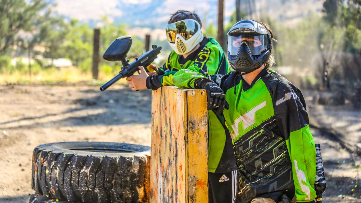 Campers posing on the paintball course