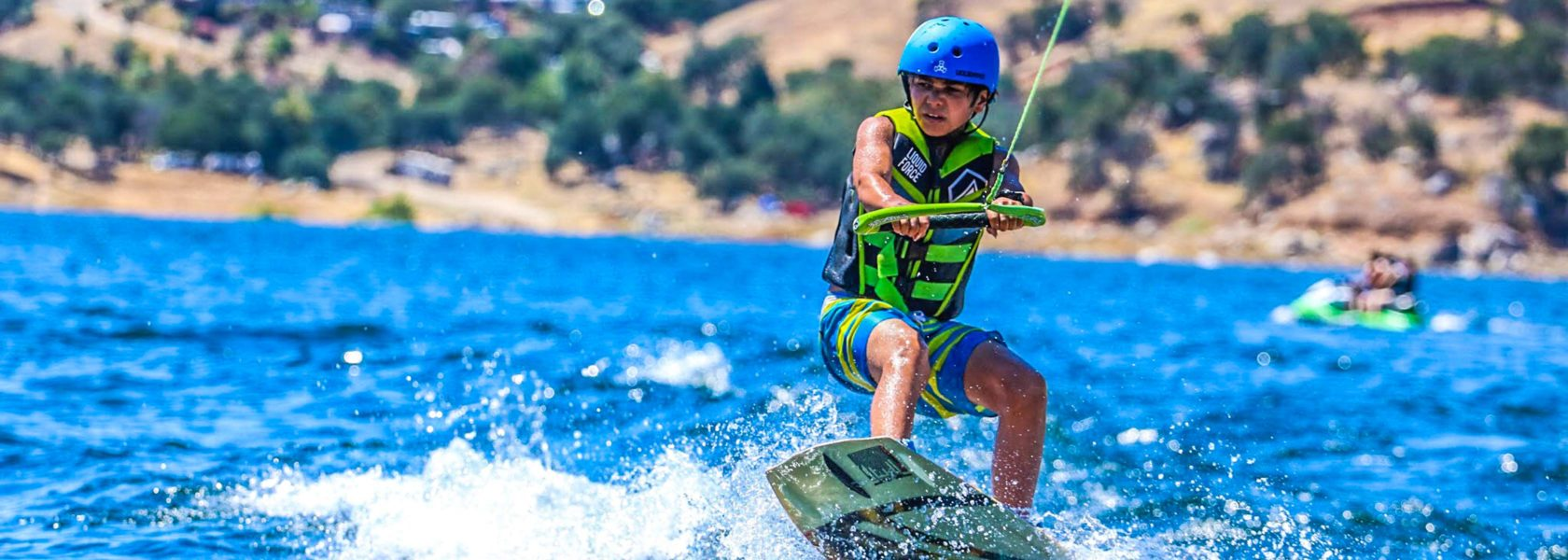 A camper wakeboarding in the lake