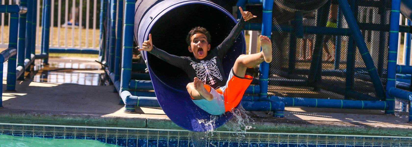A camper going down a slide
