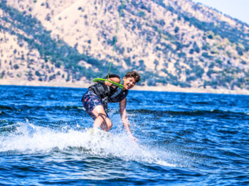 A camper learning how to wake board.