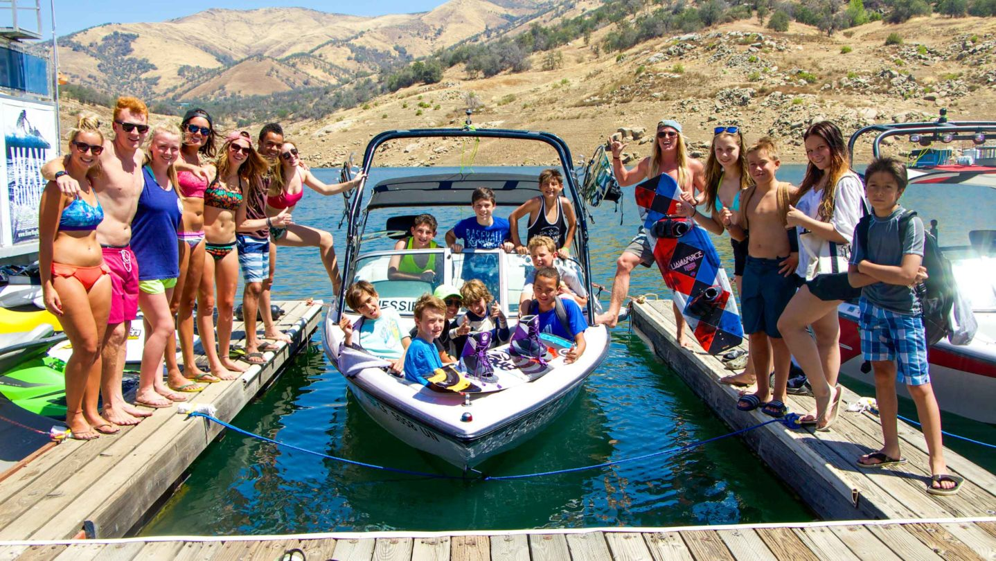 Campers getting in the boat to go waterskiing and wakeboarding