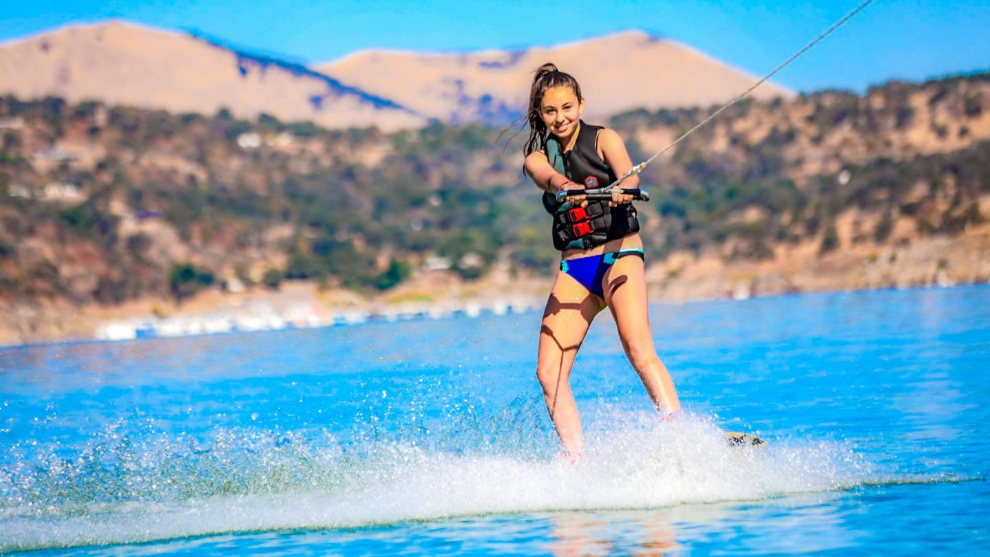 A camper learning how to waterski