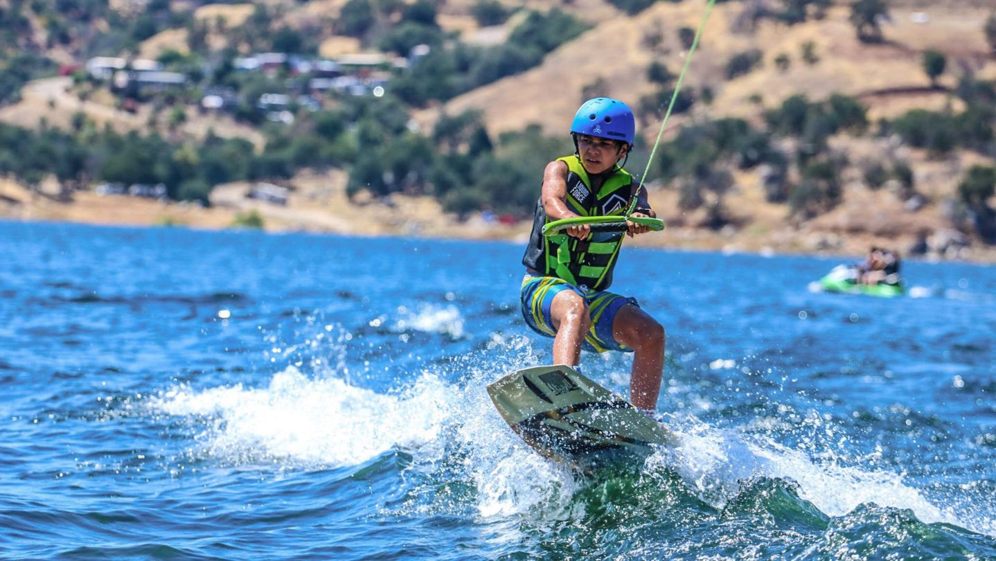A camper learning how to wakeboard