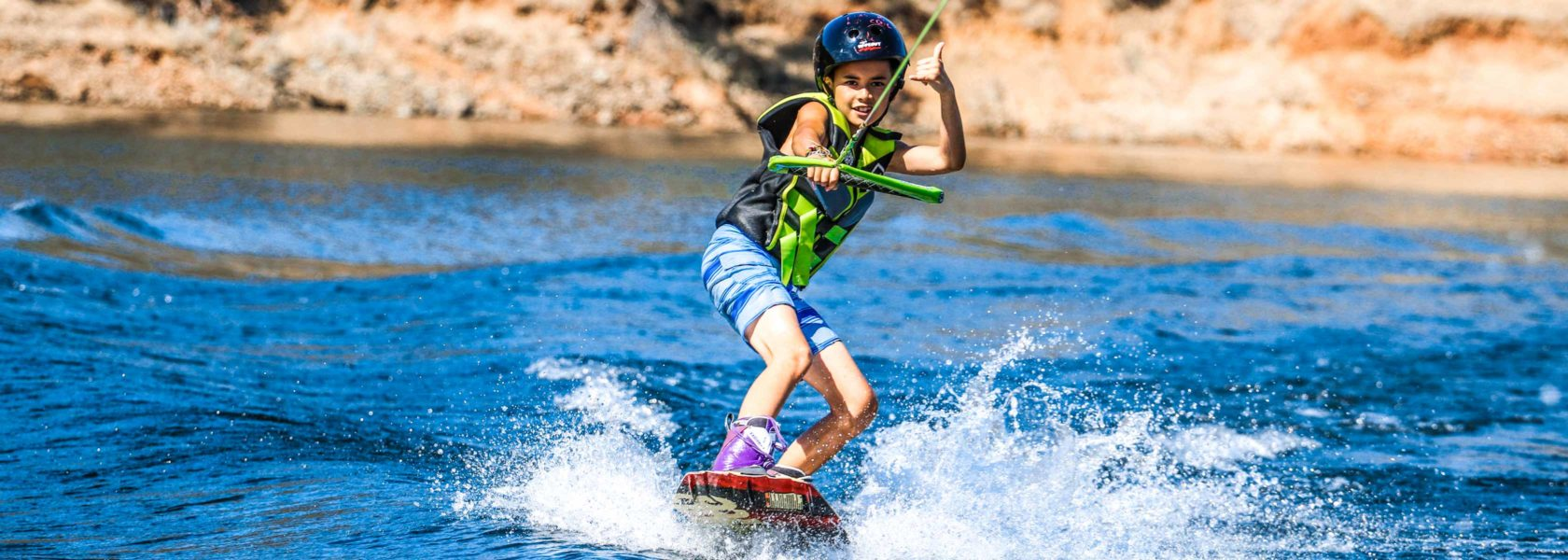 A camper waterskiing