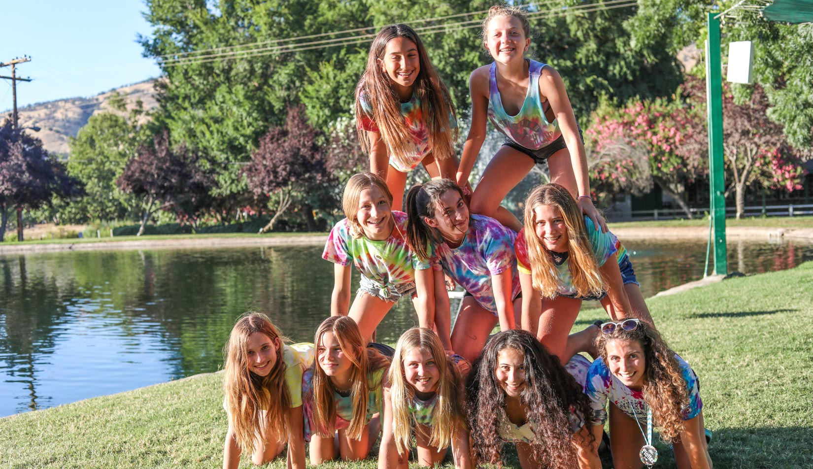 Campers posing for a group photo in a pyramid.