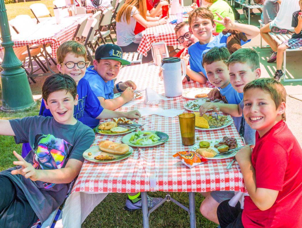 Campers enjoying a meal together