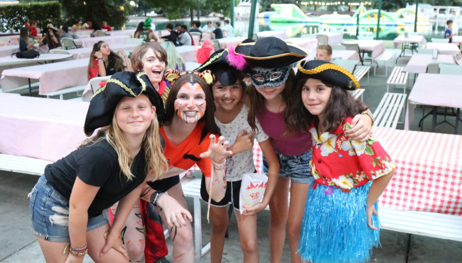 campers posing for a photo in costume